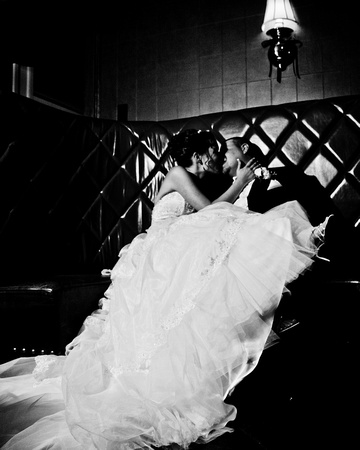 Bride and Groom Kissing in Booth